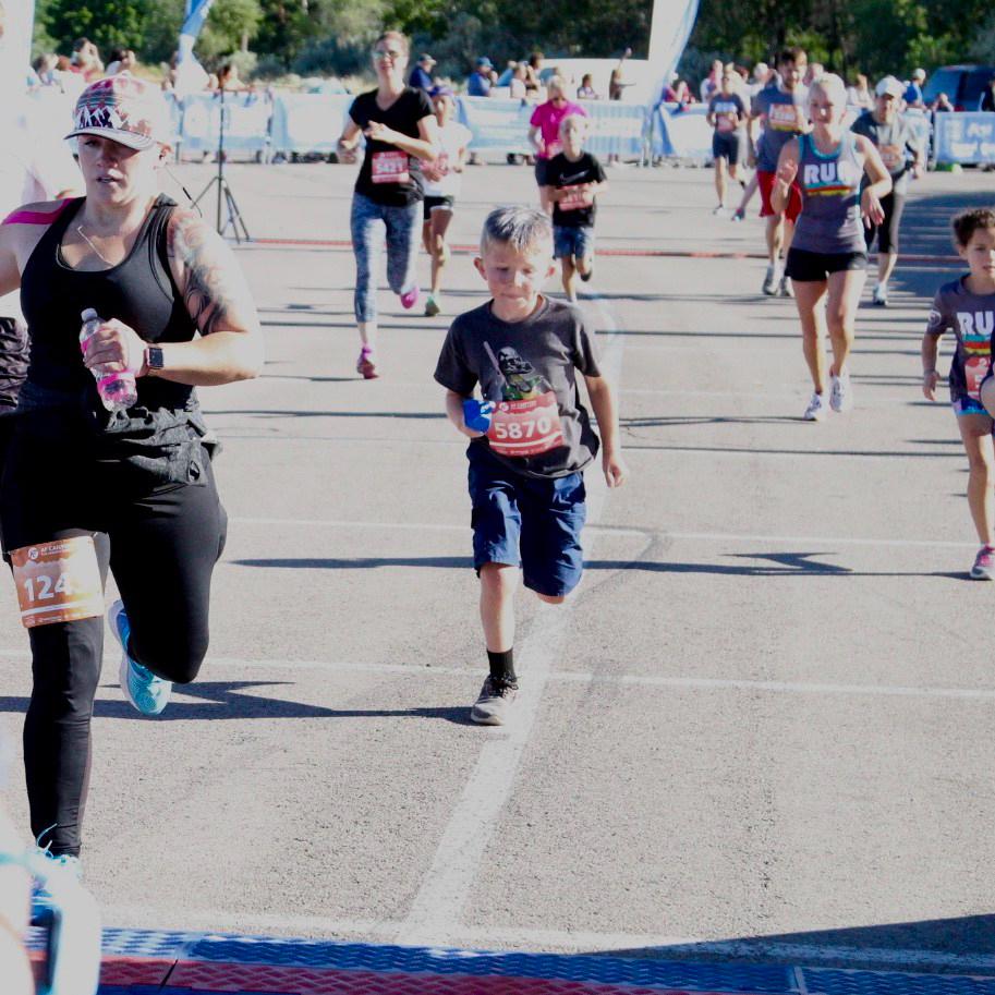 Truman crossing the finish line